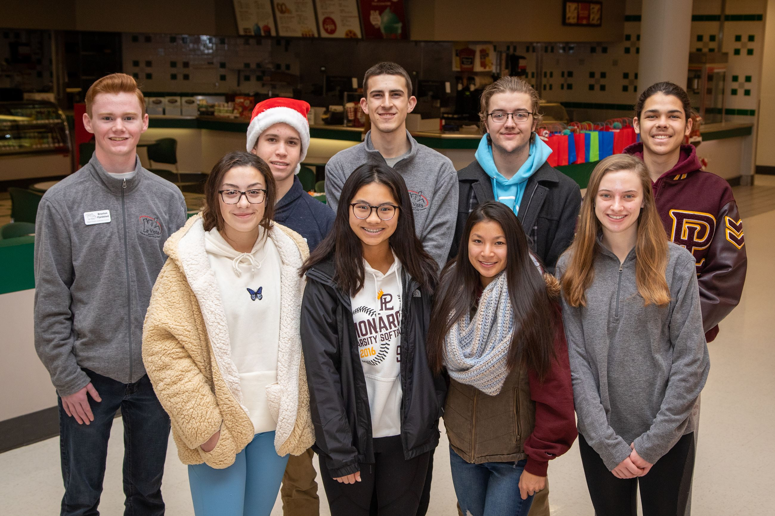 Mayor's Youth Leadership Council Members volunteering at Blue Santa 2019