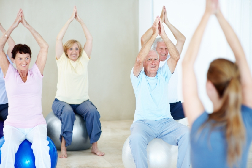 A group of older adults participating in a fitness class